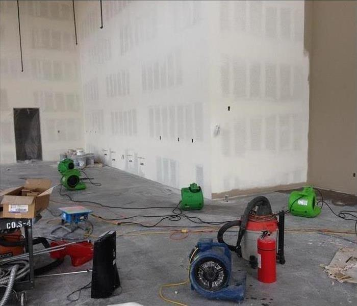 Flooded Warehouse with SERVPRO Green Equipment