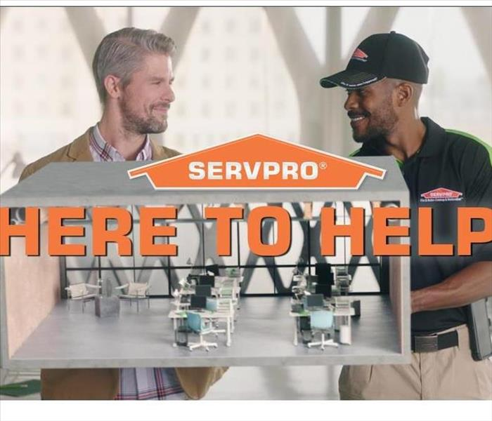 SERVPRO Here to Help with Building Manager and a SERVPRO Manager